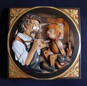 Bassorilievo Pinocchio e Geppetto