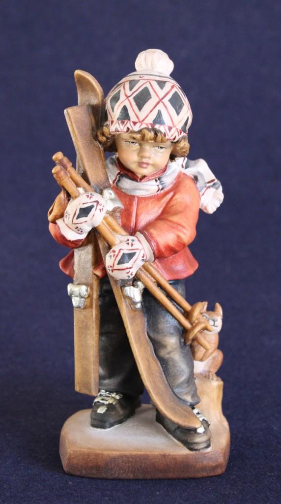 Scultura in legno bambino con sci