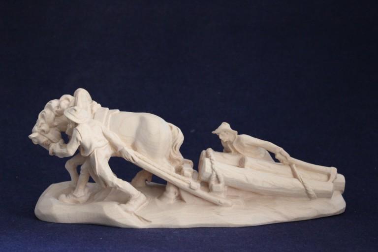 Scultura in legno: cavallo che traina i tronchi