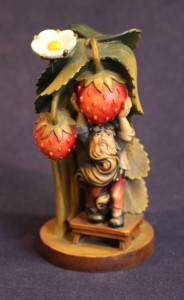 Gnome with strawberries sculpture