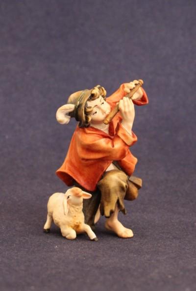 Statuina del presepe del pastorello con flauto e agnello