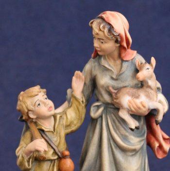 Statuina del presepe di pastorella con bambino e capretto