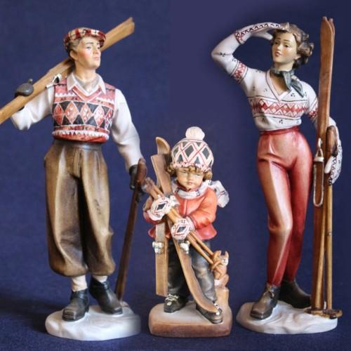 Famiglia di sciatori anni 50 scolpita in legno