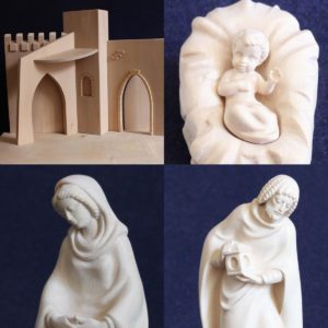 Modern Nativity scene with hut carved in wood